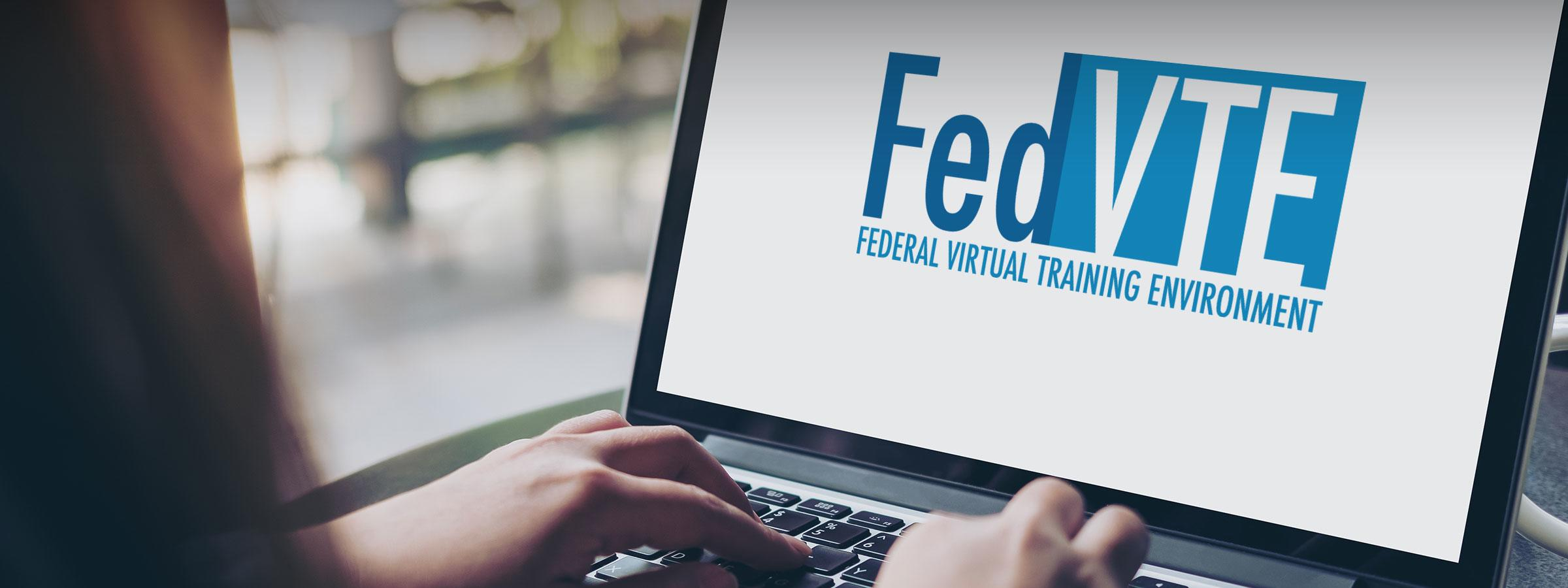 Individual at laptop on FedVTE website
