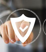 A hand shown behind a triangular shield outline with a checkmark inside of it signifying this person is making a selection for security