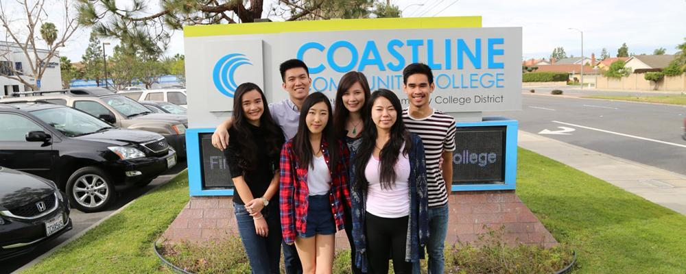 Six students in front of a Coastline Community College sign