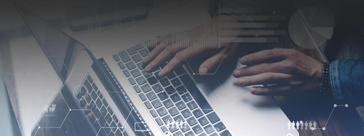 A picture of hands using a laptop, with a cyber security theme
