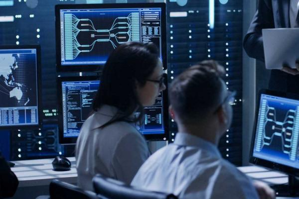 Image of individuals working in a technical and cybersecurity related environment